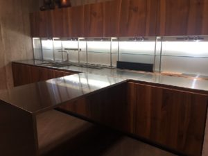 Stainless-steel-with-sleek-wood-for-a-minimalist-kitchen